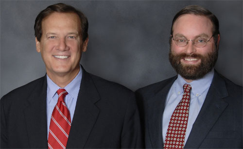 Portrait Photo of lawyers Johnnie Byrd and David Barnhill in suits and ties with